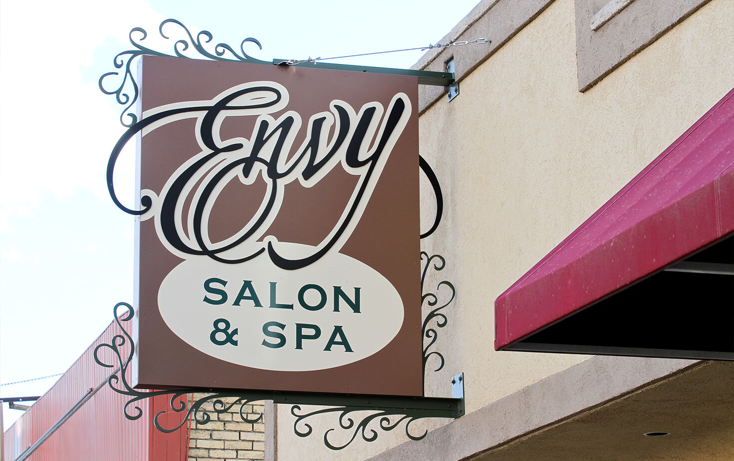 Envy Salon & Spa Wahpeton ND Wall Cabinet on Storefront with custom brackets