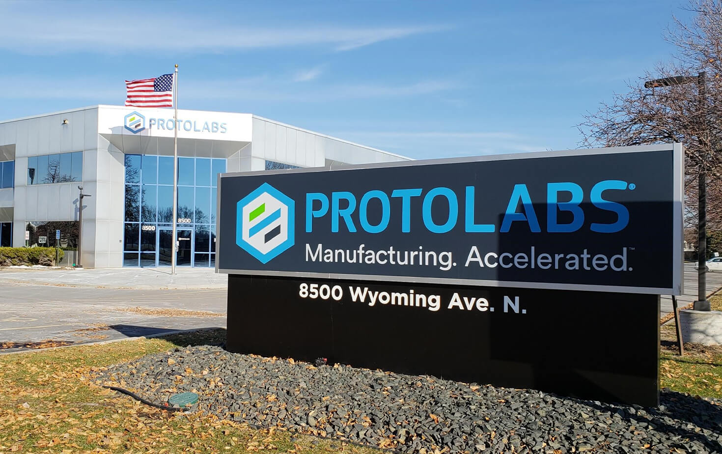 Protolabs Exterior Monument Sign in front of Building with Channel Letters Brooklyn Park MN