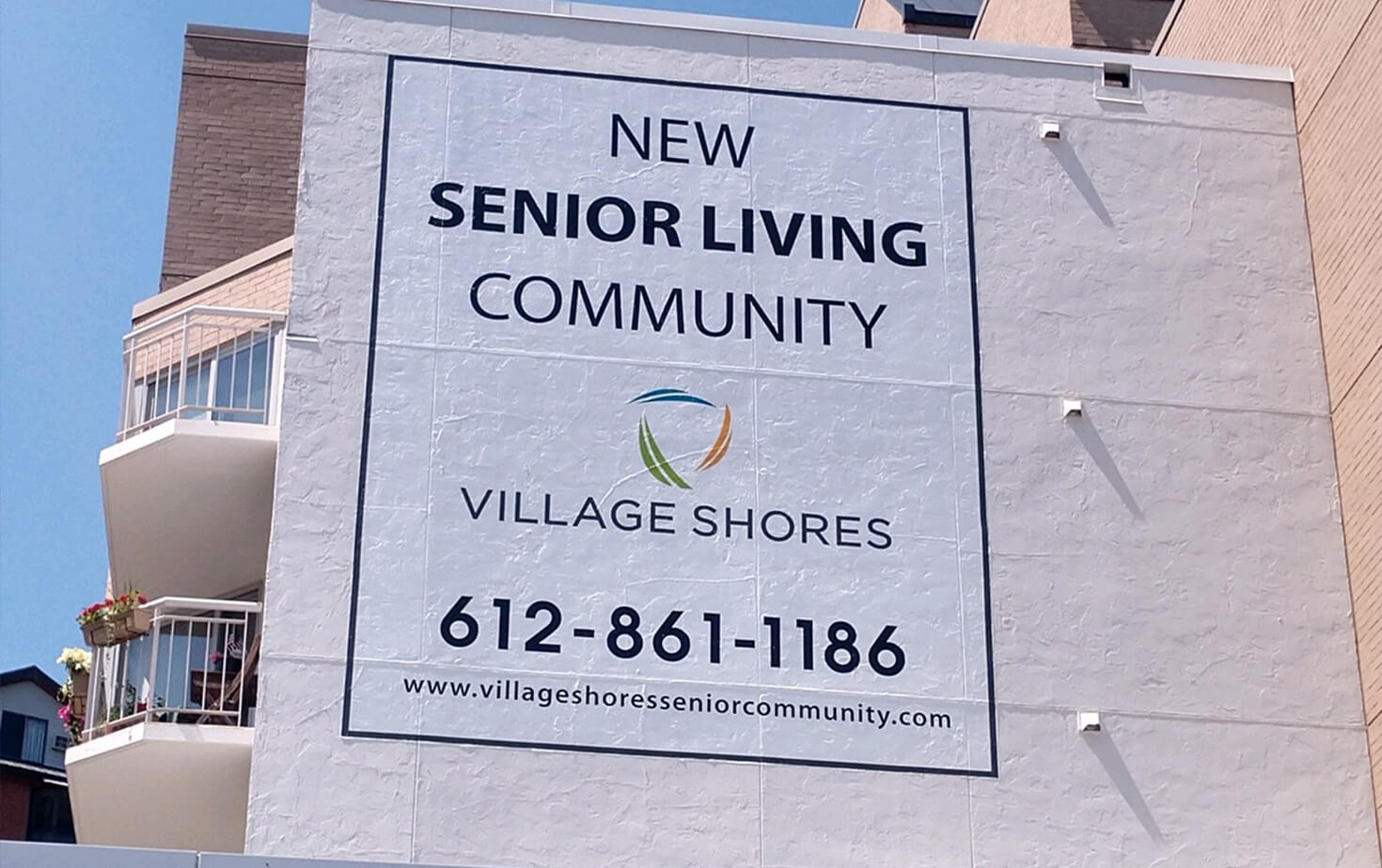 Village Shores Exterior Wall Mural on Side of Building